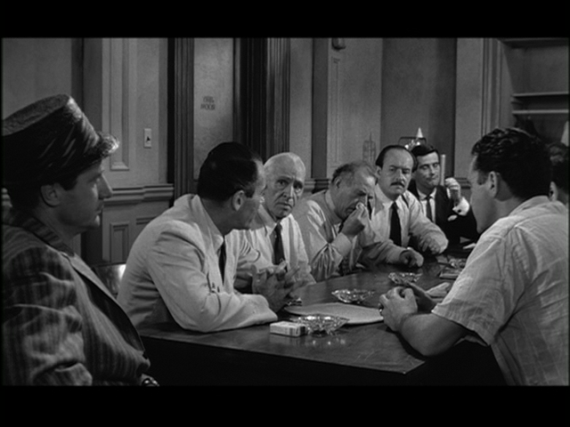 What is the background of Juror Number Eight in Twelve Angry Men?