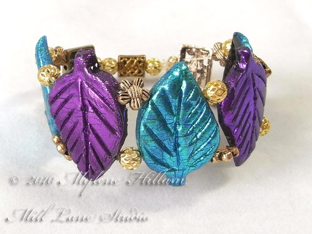 Front view of the stretch bracelet design featuring purple and turquoise Friendly Plastic leaves.