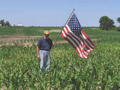 Photo of Keith, checking the corn on July Fourth.