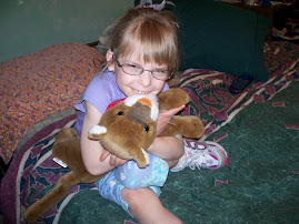 Annika shows off her new glasses & Callie the cougar