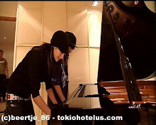 Bill y Tom tocando el piano, si esk saben hacer de todo!!!!!!