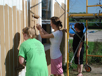 The ladies painted the whole 2-story house in just a couple of days - way to go!