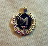 Custom company logo pendant made by Payne's Custom Jewelry