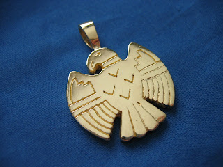 14 Karat yellow gold thunderbird custom pendant