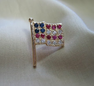 Unique custom designed gold US flag pin with genuine rubies, sapphires and diamonds