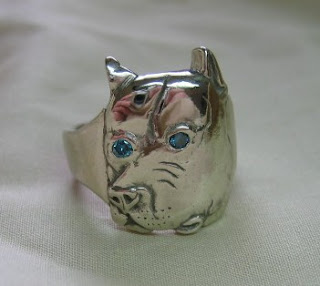 custom dog ring in white gold with blue diamond eyes