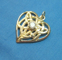 Custom designed gold pendant with diamond by Payne's Custom Jewelry