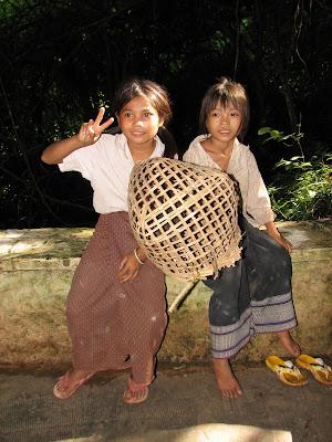kids selling birds in Laos