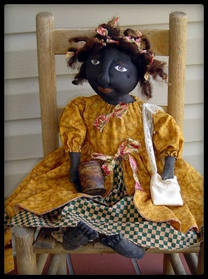 Primitive black doll with dreads