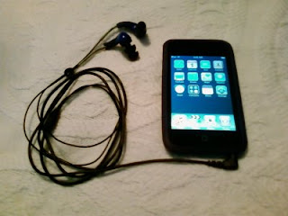 iPod touch with Atrio headphones