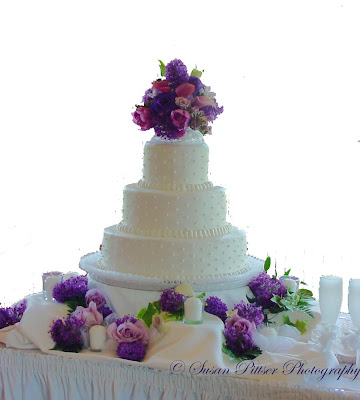 Wedding Flowers Wedding Cake With Purple Fresh Flowers To Decorate It