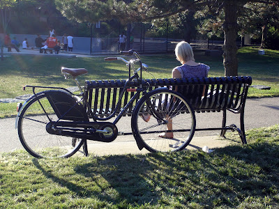 woman park bench bike Boston