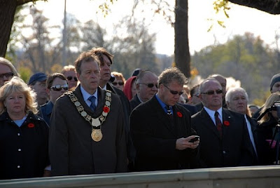 Dykstra texting during Remembrance Day Ceremony