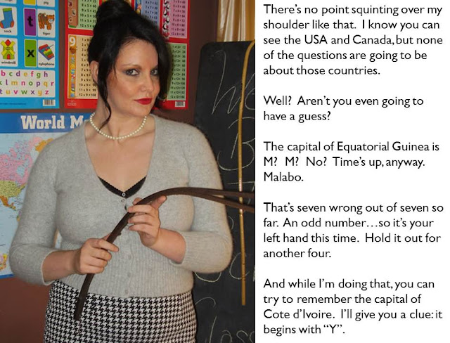 femdom caption schoolmistress with two-tailed tawse ready for handstrapping naughty pupil
