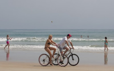 Image of bicyclists on beach at Daytona Beach