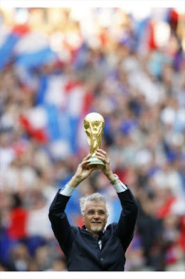France's national soccer team former coach Aime Jaquet holds the World Cup trophy ahead of an exhibition soccer match between France's 1998 World Cup Champions and a selection of players from the rest of the world, to celebrate the 10th anniversary of France's World Champion title at the Stade de France in Saint-Denis near Paris July 12, 2008