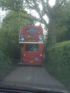 Red Double Decker Bus Driving Down Dorset Lanes