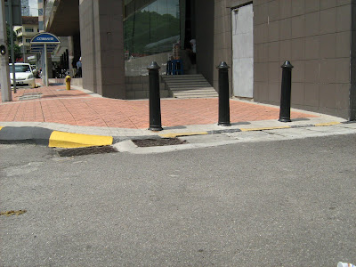 sloped surface for wheelchair access to raised curb
