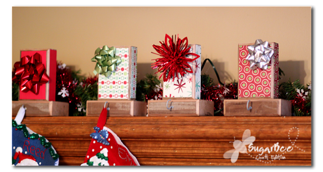 Gift Wrap DIY Stocking Hangers - Tutorial via Sugar Bee Crafts