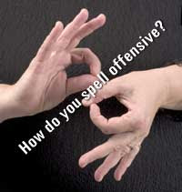 Close up of hands signing, with type superimposed that says How do you spell offensive?