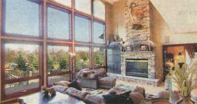 Lots of windows and a stone fireplace