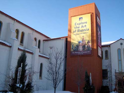 Exterior of church-turned-museum with banner reading Explore the Art of Russia