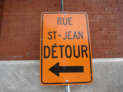 Orange traffic alert sign saying Detour Rue St. Jean