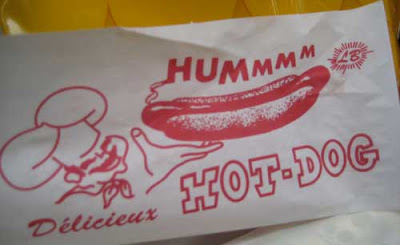 Hot dog wrapper with the word Hummmm emitting from the hotdog
