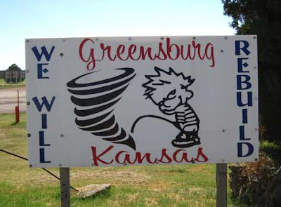 Sign reading We Will Rebuild, showing Calvin peeing on a tornado