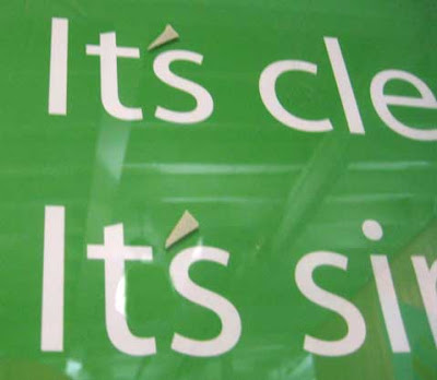 Close up of the green sign. The apostrophes in It's were added on top of the plexiglass