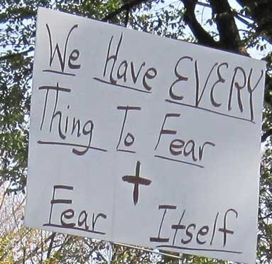 We have everything to fear and fear itself, black marker on white poster board