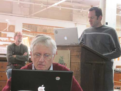 James Clough at his laptop with Bill and Jim Moran in the background