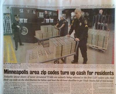 Close up of the WRME ad's photo, full width on the page, showing armed guards moving stacks of money on carts