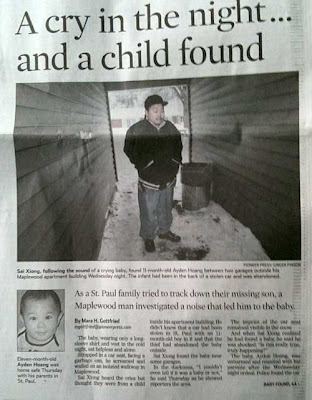 Pioneer Press article with large photo of an Asian man standing between two garages by a trash can