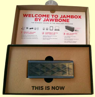 The opened Jambox package, revealing the product, a black rectangle abou 2 x 6 inches