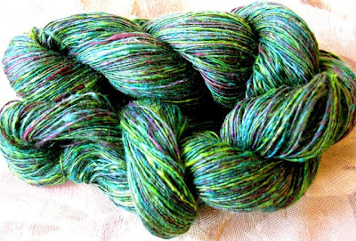 Skein of hand dyed silk hankies yarn