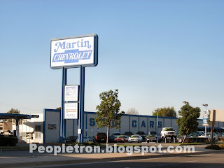 A Close Up Of The Used Car Lot With The Martin Chevrolet Sign.