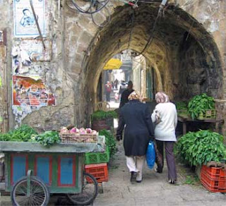 Archway in Nablus Old City with shoppers and vegetables