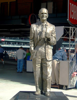 Ernie Harwell statue with him smiling and hold a microphone shows why he was honored last night by the Tigers management and fans for his many years as Tigers broadcaster.