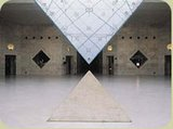 Interior view of inverted pyramid of Louvre Museum In Paris
