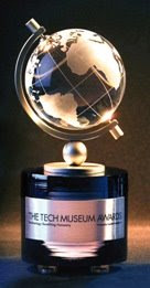 Tech Museum Award: a crystal globe atop a silicon ingot cylinder