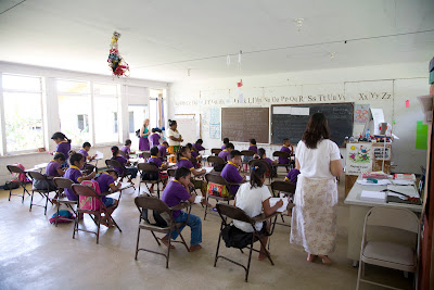 classroom with purple-clad students at desks