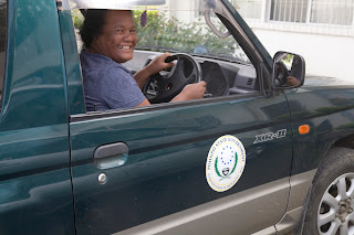 Carlina Henry at the wheel of an official Department car