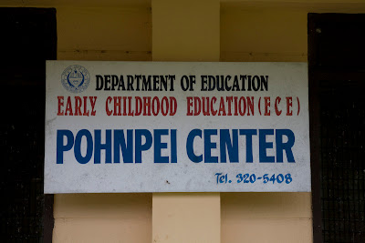 Sign saying Department of Education, Early Childhood Education (ECE), POHNPEI CENTER, tel. 320-5408