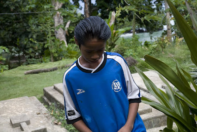 Boy wearing blue soccer jersey