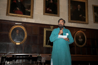 Joe Madiath in the wood paneled Exeter College dining room.