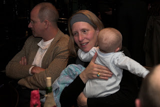 Nina Smith with baby, Will Foote in background