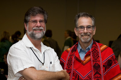 Larry Goldberg and Daniel Ben Horin in a red latin american woven poncho