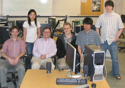 Jim Fruchterman and five students in a lab setting with computers