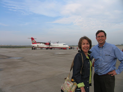 airport tarmac, Air Deccan prop plane in background, Virginia and Jim Fruchterman
